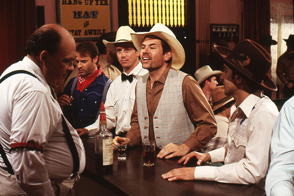 Rowdy cowboys order drinks in INCUBUS