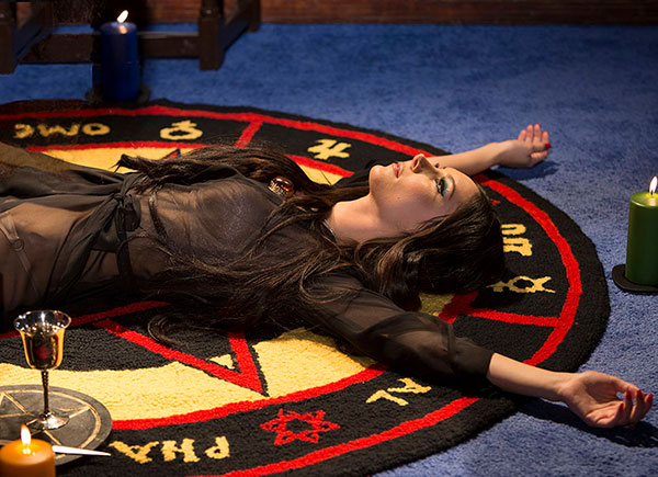 Elaine (Samantha Robinson) performs a spell on a Pentagram Rug